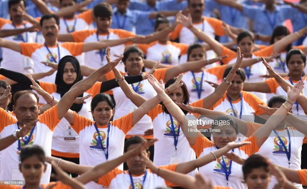 People practice Yoga on final dress rehearsal for coming International Yoga Day in early morning at Ramabai Ambedkar Maidan on June 19, 2017 in Lucknow, India. Nearly 51000 people take part in the Full Dress Rehearsal for event that will see the presence of Prime Minister Modi, Uttar Pradesh Chief Minister Yogi Adityanath and Governor Ram Naik.