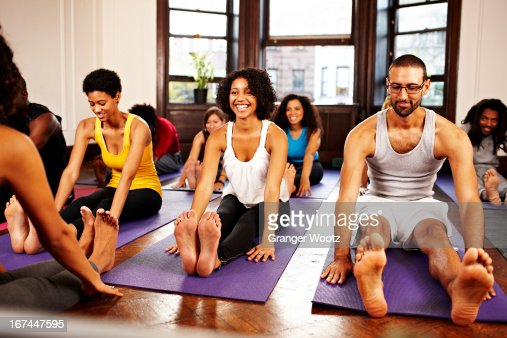 People practicing yoga in class : Stock Photo