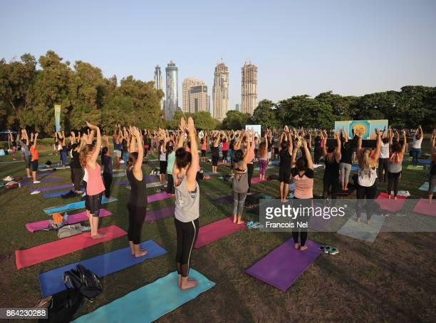 · People practise Mass Mala Yoga during the Dubai Fitness Challenge Opening Carnival at Safa Park on October 20 2017 in Dubai United Arab Emirates...