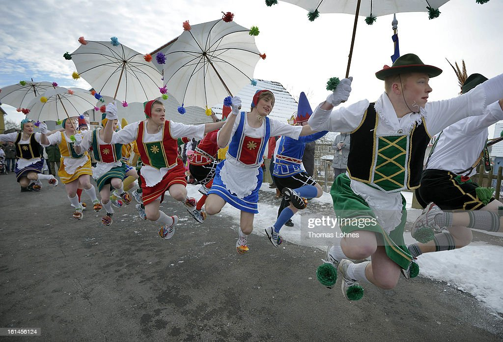 People prance during the Springerzug carnival parade on February 11, 2013 in Herbstein, Germany. The Springerzug, literally 'jumping parade', is an interpretation of carnival tradition particular to Herbstein. Niklas (l.) attend the Springerzug. Rose Monday is the highpoint of the annual carnival in the region between Mainz, Cologne and Dusseldorf, where carnival has been an annual tradition since 1823 and celebrates free-spirited merrymaking before the beginning of Lent.