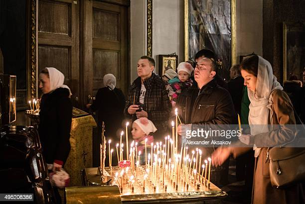 People pray and light candles during a requiem in memory of the victims of the plane crash in Kazan Cathedral on November 1 2015 in St Petersburg...