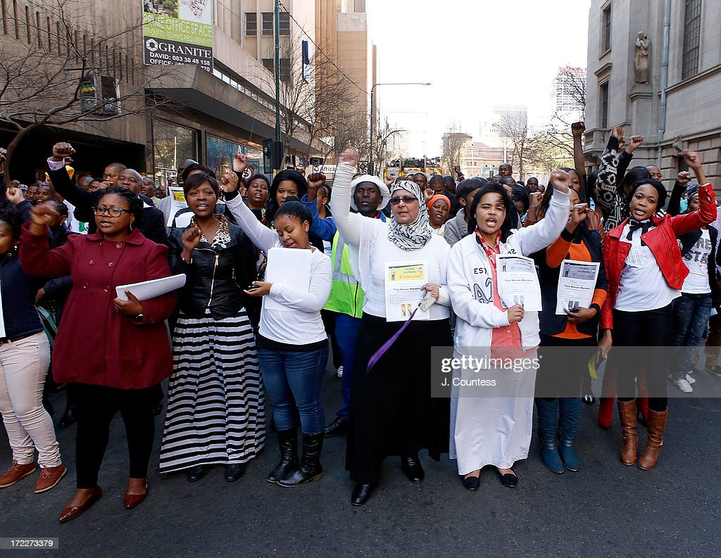 People pray and sing songs of support for former South African President Nelson Mandela during an African National Congress-sponsored prayer rally outside ANC headquarters on July 2, 2013 in Johannesburg, South Africa. The anti-apartheid icon and Nobel Peace Prize Laureate has been in the hospital for more than three weeks being treated for a recurring lung infection.