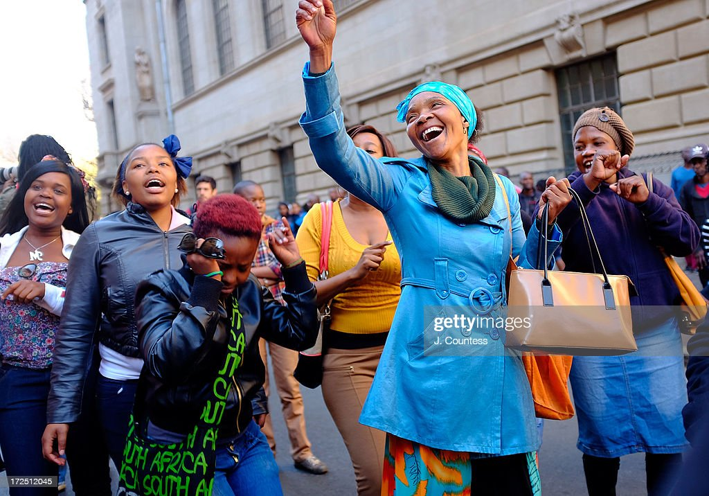 People pray and sing songs of support for former South African President Nelson Mandela during an African National Congress-sponsered prayer rally outside ANC headquarters on July 2, 2013 in Johannesburg, South Africa. The anti-apartheid icon and Nobel Peace Prize Laurete has been in the hospital for more than three weeks being treated for a recurring lung infection.