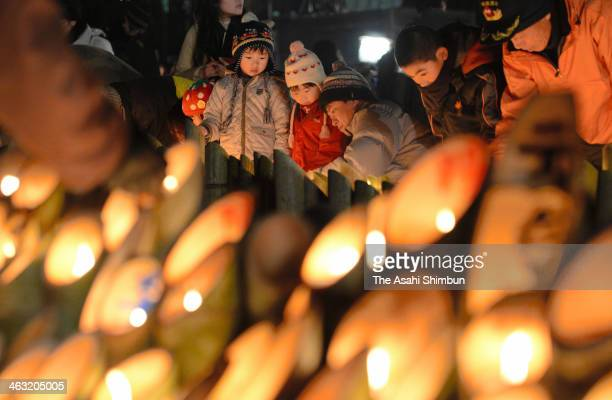 People pray at 546 am in memory of the victims of the Great Hanshin Earthquake in 1995 at Higashi Yuenchi park on January 17 2014 in Kobe Hyogo Japan...