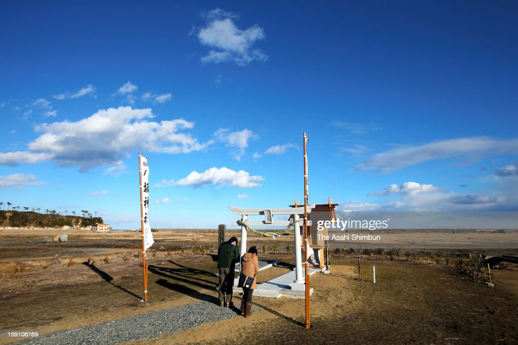People pray at a small shrine on Janaury 1, 2013 in Minamisoma, Fukushima, Japan. Japan mark the second new year after the earthquake and tsunami.