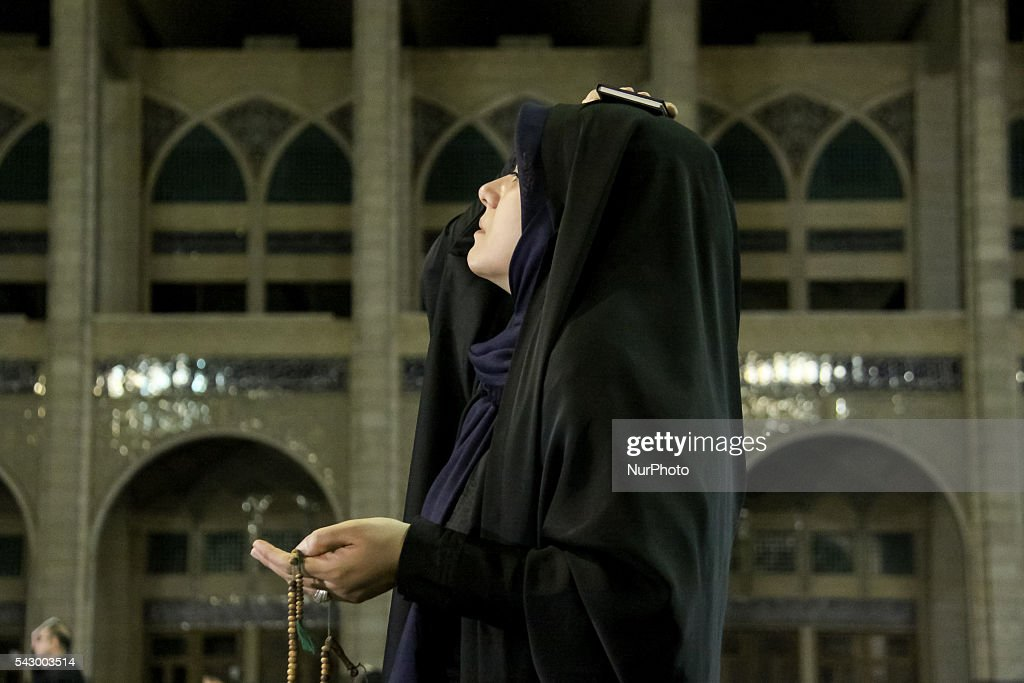People pray at Mosalla Mosque on the 19th day of Ramadan as eventual Laylat al-Qadr (Night of Power), One of the Muslim's holiest nights, in Tehran, Iran on June 24, 2016. Iranian people assume that 19th, 21st and 23rd days of Ramadan are probable Laylat al-Qadr night and named as Shab-i Ihya. They gather in mosques on these three nights and pray until the morning.