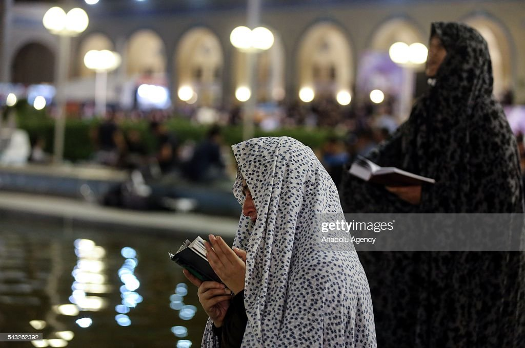 People pray at Mosalla Mosque on the 21th day of Ramadan as eventual Laylat al-Qadr (Night of Power), One of the Muslim's holiest nights, in Tehran, Iran on June 27, 2016. Iranian people assume that 19th, 21st and 23rd days of Ramadan are probable Laylat al-Qadr night and named as Shab-i Ihya. They gather in mosques on these three nights and pray until the morning.