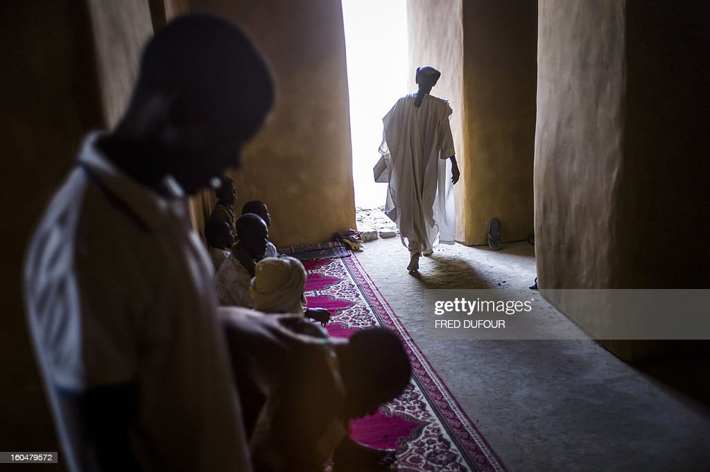 People pray at the Djingareyber mosque in Timbuktu on February 1, 2013. The fabled desert city of Timbuktu, an ancient centre of Islamic learning, has been recaptured on January 28 by French-led forces in their offensive against Islamist rebels who have been occupying Mali's north since last April.