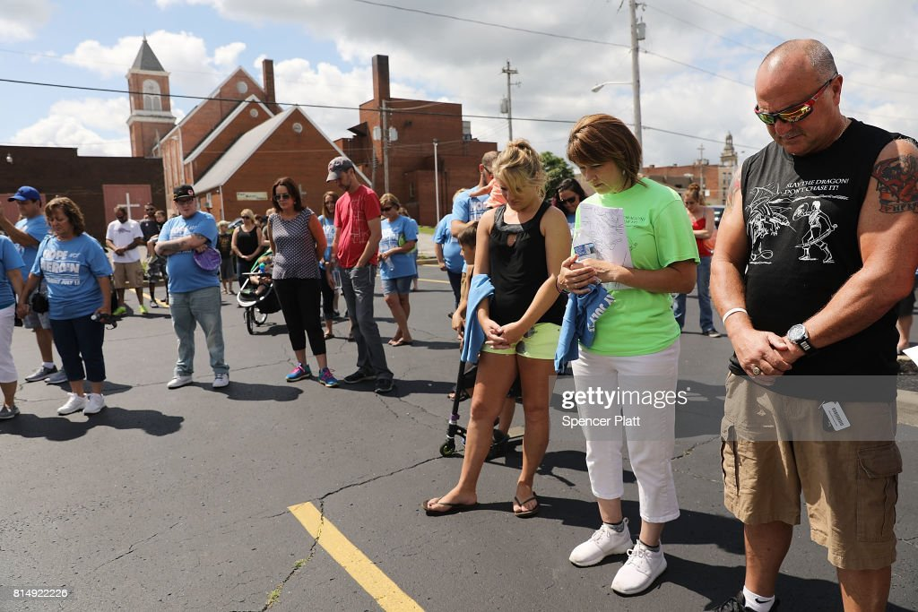 People pray before setting out on a march through the streets of Norwalk against the epidemic of heroin in their community on July 14, 2017 in Norwalk, Ohio. The day of action, called Hope Not Heroin, featured a march, speakers, and live bands. According to recent statistics, at least 4,149 Ohioans died from drug overdoses in 2016, a 36 percent leap from just the previous year and making Ohio the leader in the nation's overdose deaths.