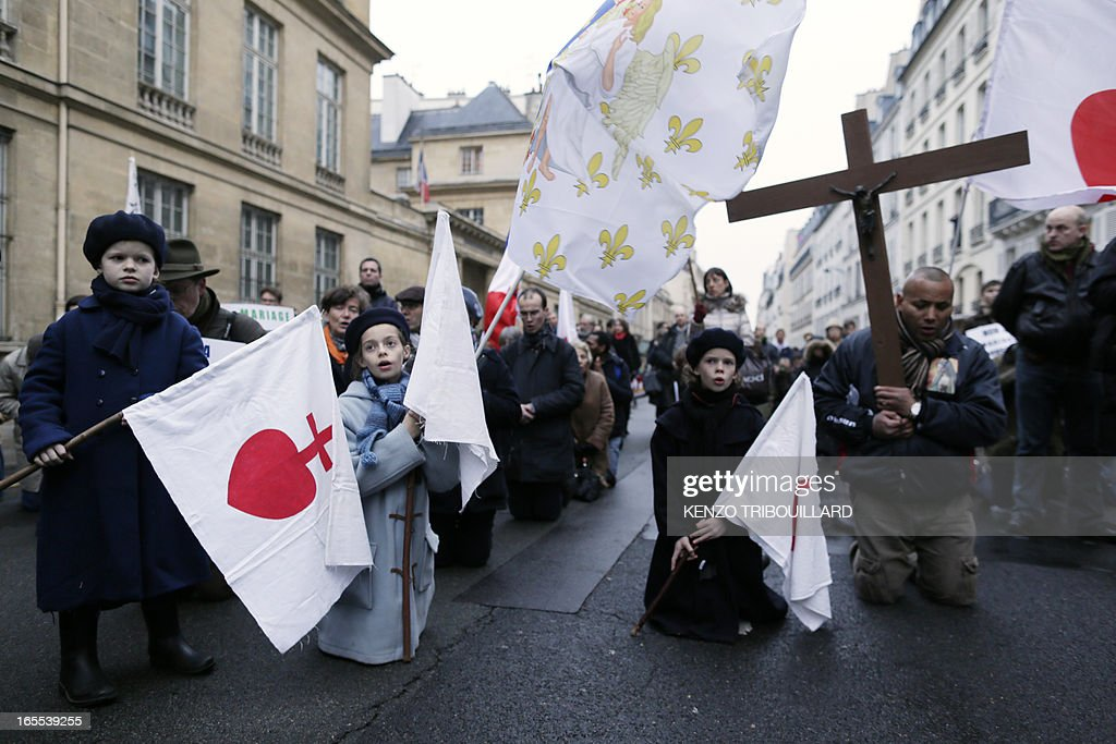 People pray during a protest organized by fundamentalist Christians group Civitas Institute against same-sex marriage on April 4, 2013 in front of the French Senate in Paris on the first day of the debate at France's upper house on the controversial bill to legalise same-sex marriage and adoption. While the upper house is unlikely to reject the groundbreaking reform, it is still expected to be a tight vote as the ruling Socialists enjoy a smaller majority in the Senate than in the National Assembly.