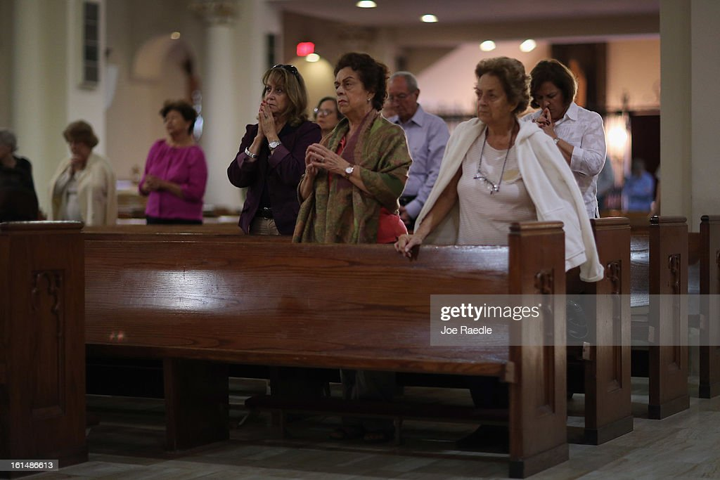 People pray during a service at the Church of the Little Flower on February 11, 2013 in Coral Gables, Florida. Parishioners today were dealing with the unexpected news that Pope Benedict XVI announced his retirement, now the wait begins to learn who his successor will be.