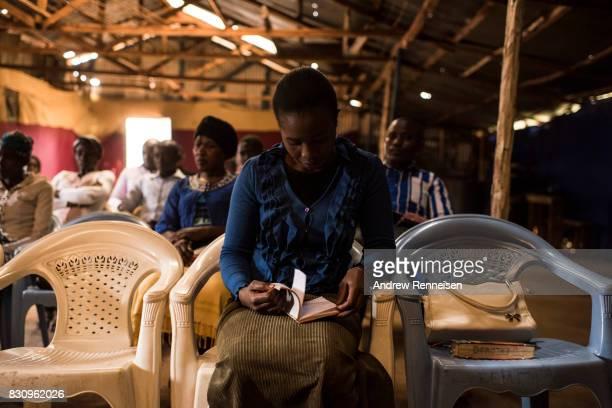 People pray during Sunday service at Fullgospel Evangelistic Ministry in the Kibera slum on August 13 2017 in Nairobi Kenya A day prior...