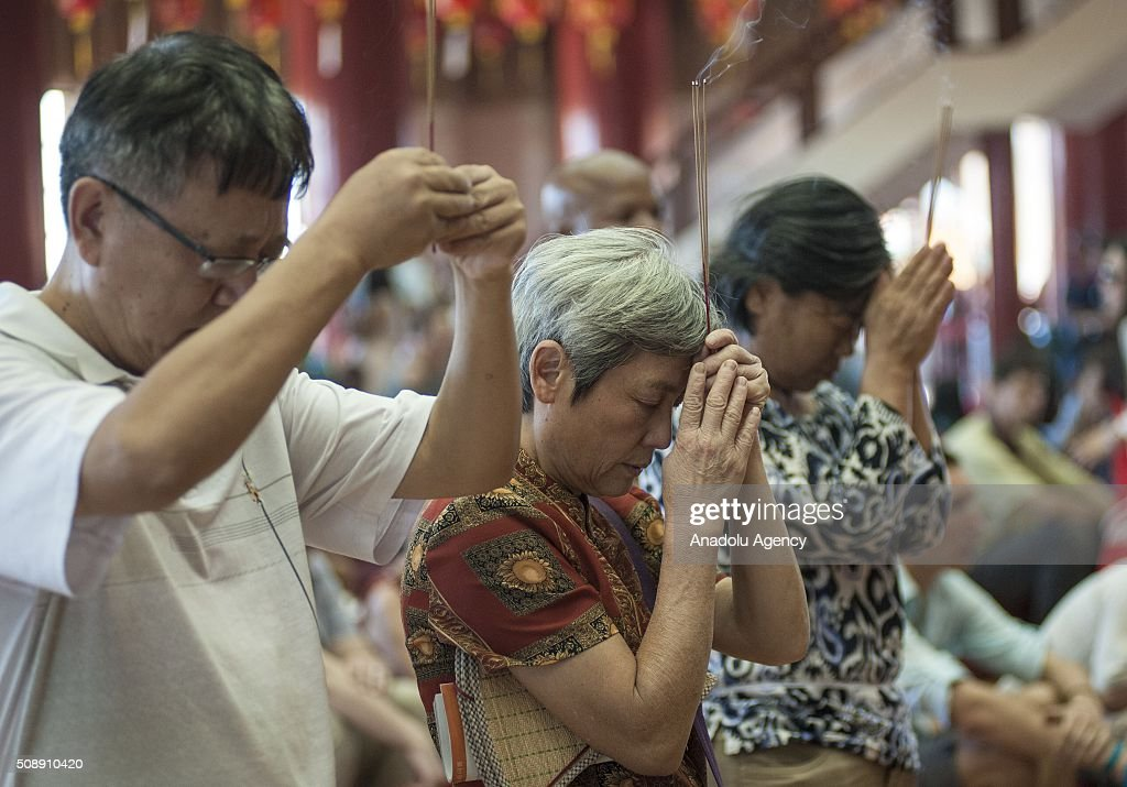 People pray during the celebrations at Nan Hua Temple in Pretoria on February 7, 2016 ahead of the upcoming Chinese Lunar New Year. The Chinese New Year will start on February 8th and will be the year of the fire monkey.