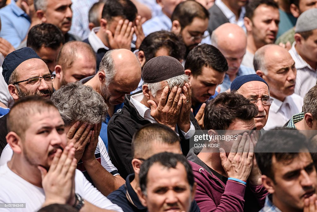 People pray during the funerals of Maryam Amiri, Karime Amiri, Zahra Amiri and Huda Amiri on June 30, 2016 two days after they were killed by a suicide bombing and gun attack targeted Istanbul's Ataturk airport, killing 42 people. The death toll from the triple suicide bombing and gun attack that occurred on June 28, 2016 at Istanbul's Ataturk airport has risen to 43 including 19 foreigners. The government has pointed the finger of blame at the Islamic State group and Turkish police rounded up 13 suspected IS jihadists in raids at 16 different locations across Istanbul on June 30. KOSE