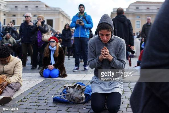 People pray during the Inauguration Mass for Pope Francis in St Peter's Square on March 19 2013 in Vatican City Vatican The mass is being held in...