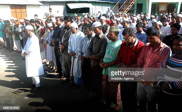 People pray during the Jamaat e Islamis Secretary General Ali Ahsan Muhammad Mujahid's burial ceremony near his ancestral home in Faridpur Bangladesh...