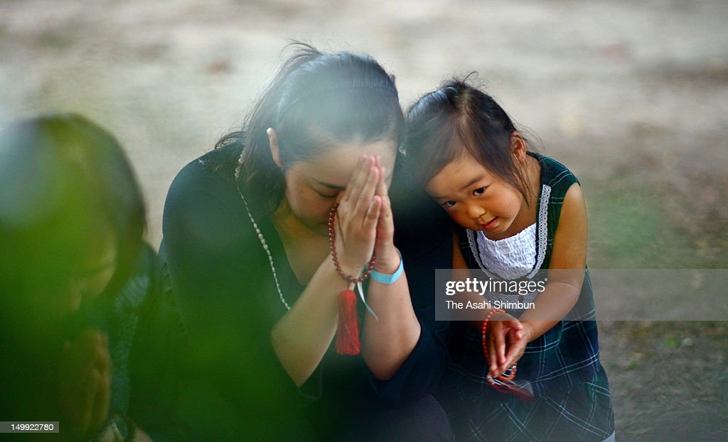 People pray for the atmic bomb victims at a monument at the Hiroshima Memorial Park on August 6, 2012 in Hiroshima, Japan. Hiroshima marks the 67th anniversary of its atomic bombing under the shadow of the Fukushima nuclear disaster and by issuing a plea for complete nuclear disarmament.