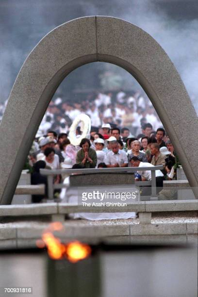 People pray for the victim in front of the cenotaph on the 50th anniversary of the atomic bomb dropped at Hiroshima Peace Memorial Park on August 6...