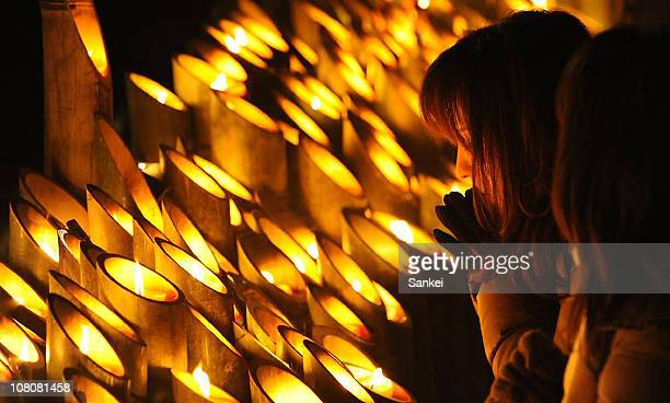 People pray for the victims of Kobe Great Earthquake in 1995 which killed more than 6000 people on January 17 2011 in Kobe Hyogo Japan