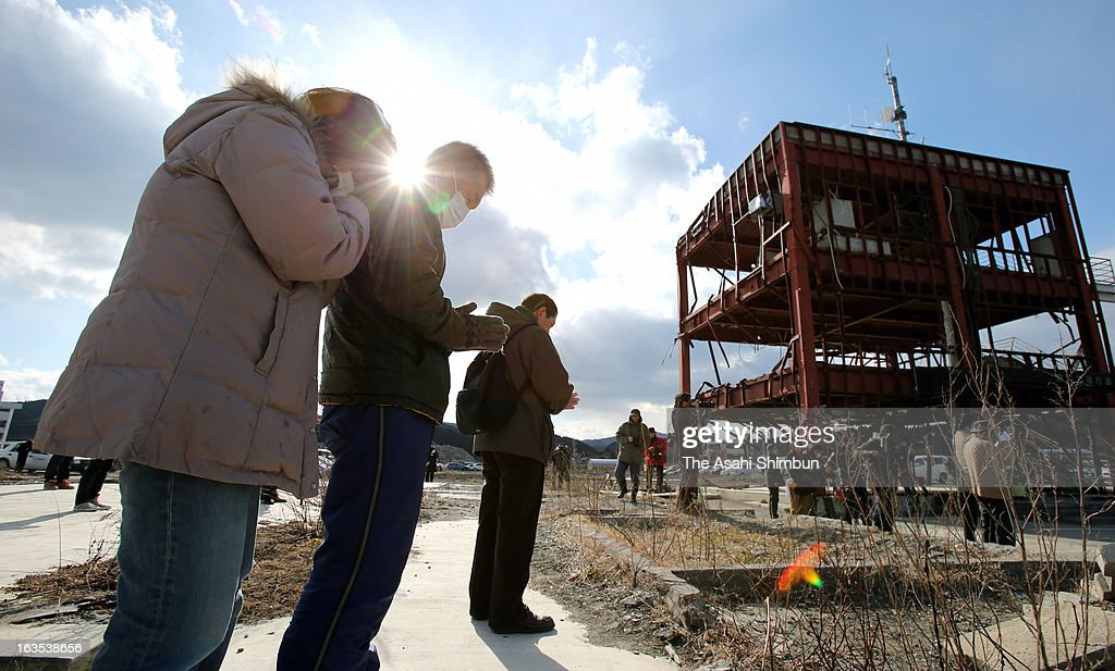 People pray for the victims of the Magnitude 9.0 Earthquake and tsunami at former Minamisanriku Disaster Prevention Center on March 11, 2013 in Minamisanriku, Miyagi, Japan. Japan commemorates second anniversary of the Magnitude 9.0 earthquake and subsequent tsunami, that claimed more than 18,000 lives.