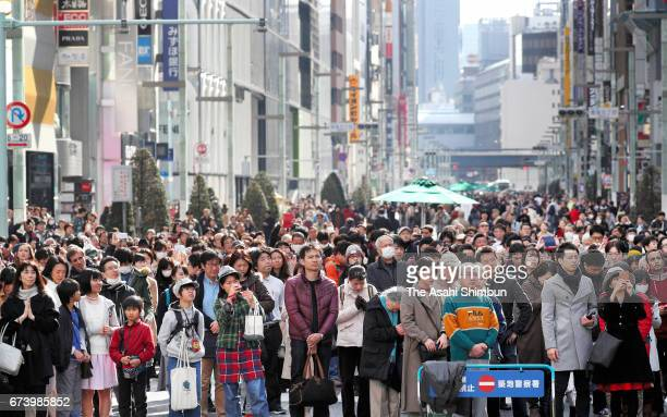 People pray for the victims on 1446 on the sixth anniversary of the Great East Japan Earthquake and following tsunami at Ginza area on March 11 2017...