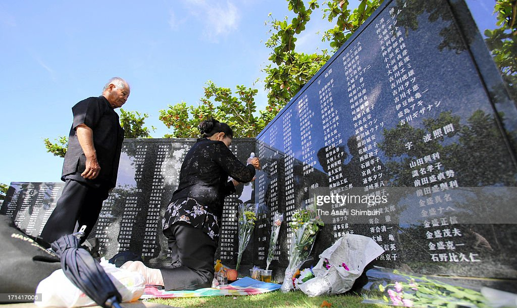 People pray for the war dead in front of Heiwa-no-Ishiji or 'Cornerstone of Peace', the memorial to commemorate Okinawa-related war victims, at Okinawa Prefecture Peace Memorial Park on June 23, 2013 in Itoman, Okinawa, Japan. During the 3-month ground battle at the end of World War II, more than 200,000 people were killed.