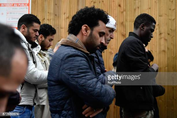 People pray in a street on November 2017 in Clichy near Paris while the city mayor demonstrate with others political leaders against muslim streets...