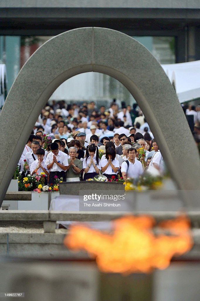 People pray in front of a monument for atomic bomb vicitims at the Hiroshima Peace Memorial Park on August 6, 2012 in Hiroshima, Japan. Hiroshima marks the 67th anniversary of its atomic bombing under the shadow of the Fukushima nuclear disaster and by issuing a plea for complete nuclear disarmament.