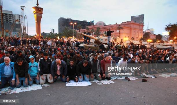 People pray in front of army tanks in Tahrir Square on January 30 2011 in Cairo Egypt Cairo remained in a state of flux and marchers continued to...