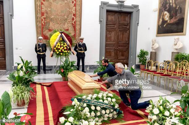 People pray in front the coffin of Italian actor Paolo Villaggio lying in repose at Rome's city hall in front the coffin of Italian actor Paolo...