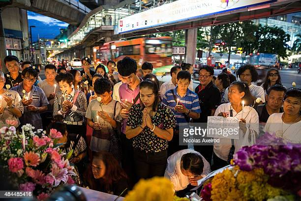 People pray in front the Erawan Shrine on August 19 2015 in Bangkok Thailand On Monday evening Bangkok was hit by what has been described as...