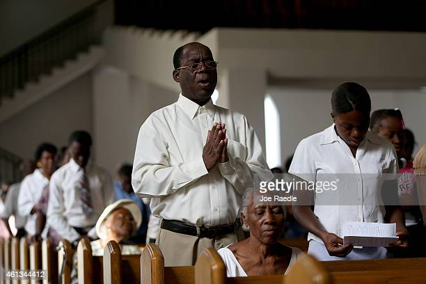 People pray in the new church built next to the National Cathedral that was destroyed five years ago by a magnitude 70 earthquake that struck just...