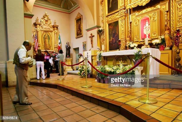 People pray inside the Iglesia de la Placita at Nuestra Senora Reina de Los Angeles or Our Lady Queen of Angeles Church March 31 2005 in Los Angeles...