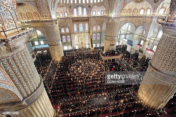 People pray on November 28 2014 at the Blue Mosque in Istanbul Pope Francis will visit Turkey on November 2830 eight years after his predecessor...