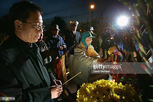 People pray on the eve of the 30th anniversary of the Fall of Saigon on April 29 2005 at the Vietnam War Memorial in Westminster California...