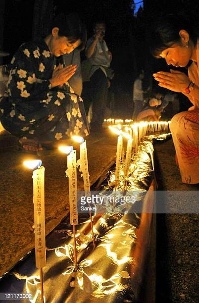 People pray the victims of Tohoku Earthquake in front of candles at Koyasan Okunoin on August 13 2011 in Koya Wakayama Japan