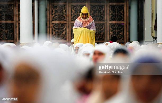 People pray to commemorate the tenth anniversary of the Boxing Day tsunami at a mosque on December 25 2014 in Banda Aceh Indonesia Aceh was the worst...