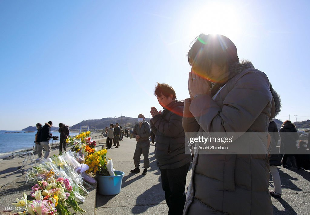 People pray toward the sea in remembrance of the earthquake and tsunami victims on March 11, 2013 in Iwaki, Fukushima, Japan. Japan commemorates second anniversary of the Magnitude 9.0 earthquake and subsequent tsunami, that claimed more than 18,000 lives.