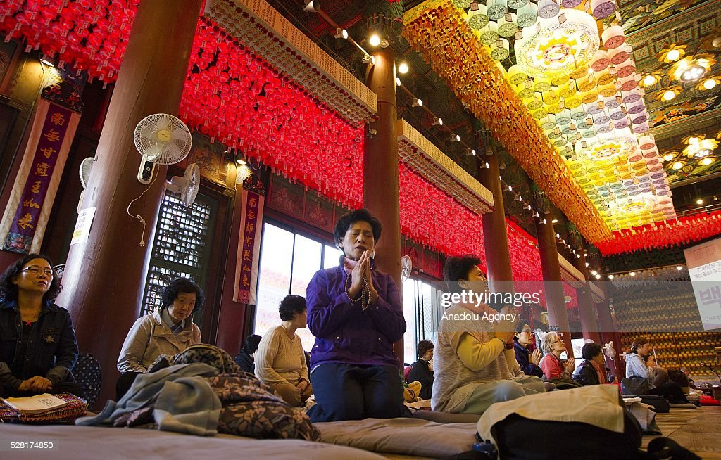 People pray under lanterns during a buddhist service to celebrate Buddha's birthday at the Jogye temple on May 4, 2016 in Seoul, South Korea.