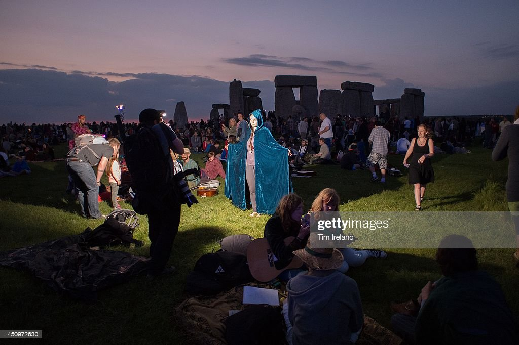 People prepare for the summer solstice dawn celebrations as druids, pagans and revellers gathered the night before the Summer Solstice sunrise at Stonehenge on June 20, 2014 in Wiltshire, England. A sunny forecast brought thousands of revellers to the 5,000 year old stone circle in Wiltshire to see the sunrise on the Summer Solstice dawn. The solstice sunrise marks the longest day of the year in the Northern Hemisphere.
