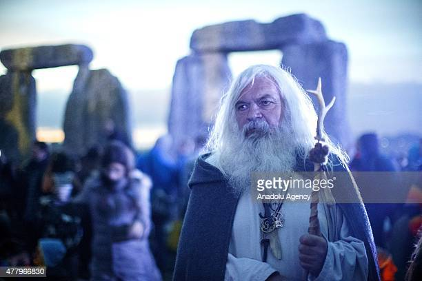 People prepare for the summer solstice dawn celebrations as druids pagans and revellers gathered the night before the Summer Solstice sunrise at...