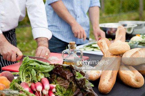 People preparing food outdoors : Stock Photo