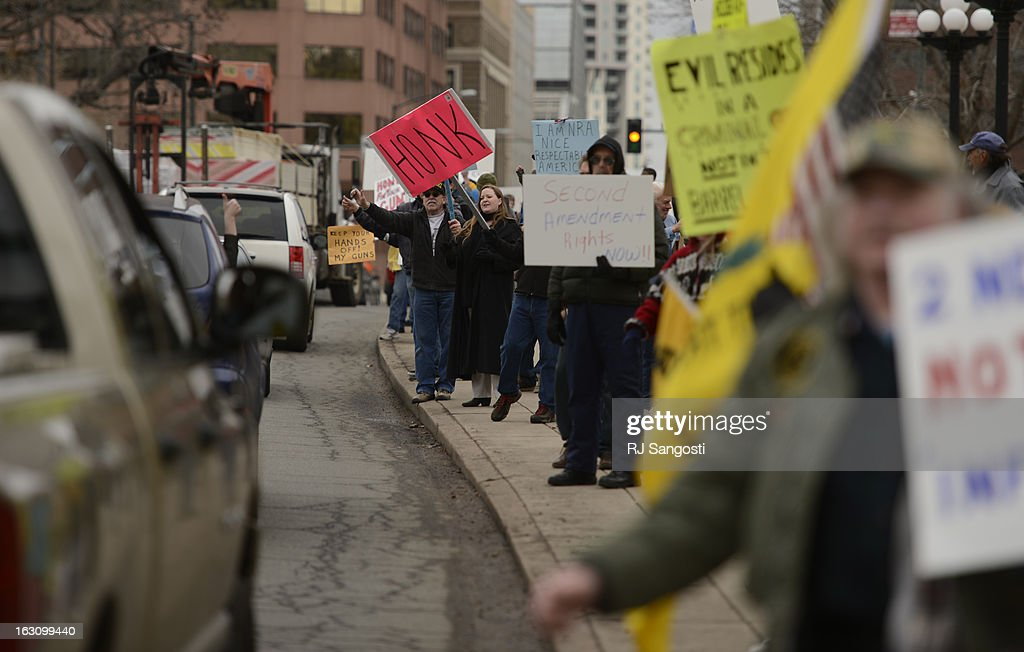 People, proposed to future gun laws, line the sidewalks for a rally, March, 04, 2013, outside the Colorado State Capitol.