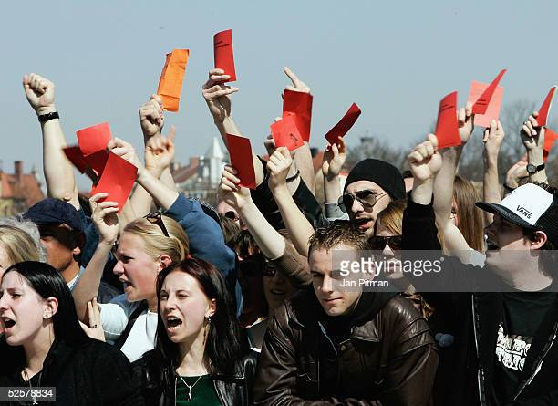 People protest against a march of NeoNazis on April 2 2005 in Munich Germany