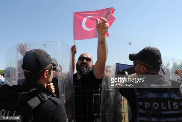 People protest against arrested soldiers who participated in last year's attempted coup d'etat as they arrive for their trial at Sincan Penal...