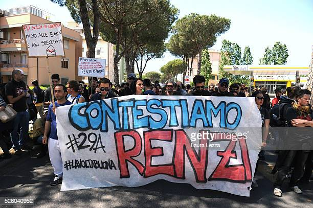 People protest against Italian prime Minister Matteo Renzi with a banner that says 'Contestiamo Renzi' after the celebration of the 30th anniversary...