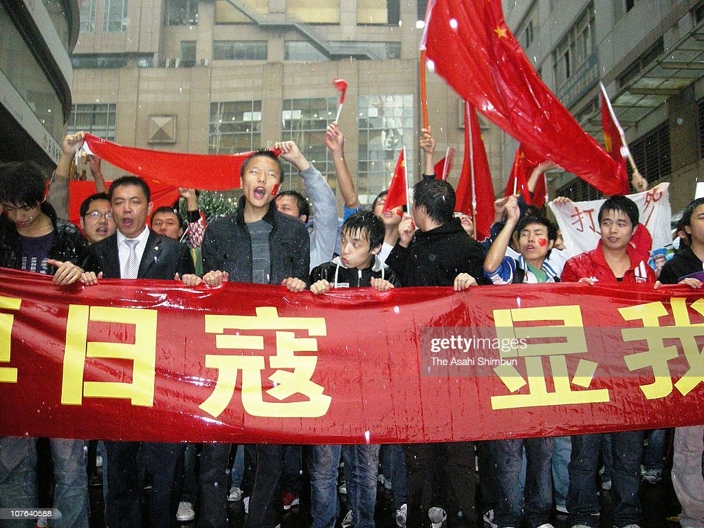 People protest against Japan in front of the Japan Consulate General on October 26, 2010 in Chongqing, China.