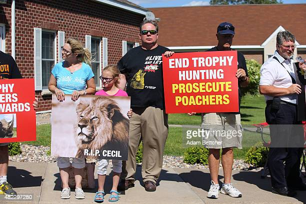 People protest against poaching after the death of Cecil the lion in the parking lot of Dr Walter Palmer's River Bluff Dental Clinic on July 29 2015...