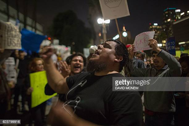People protest against the appointment of white nationalist altright media mogul former Breitbart News head Stephen Bannon to be chief strategist of...