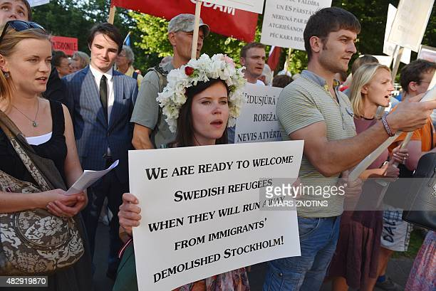 People protest against the arival of refugees in Latvia near a government building in Riga on August 4 2015 AFP PHOTO / ILMARS ZNOTINS